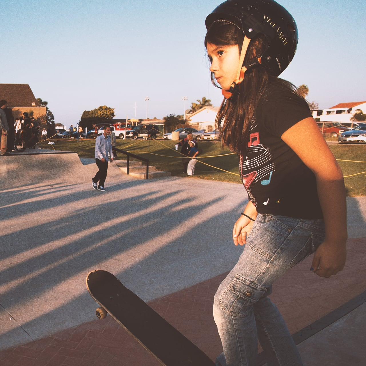 Image of girl ready to skateboard.