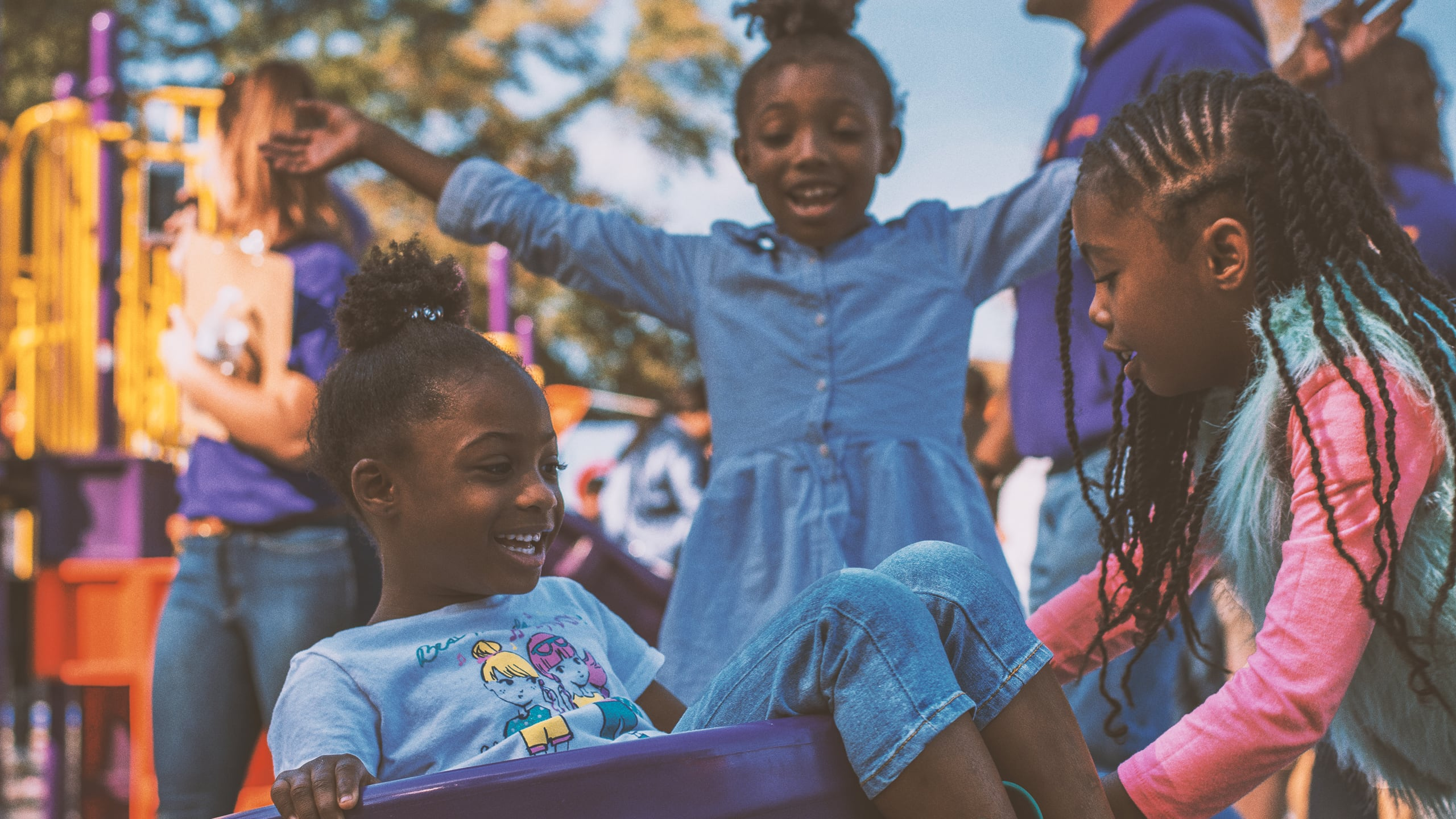Image of girls playing on play set